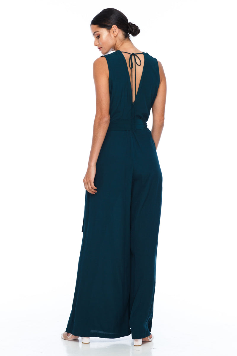 A BLAK Bridesmaid Piece - The Keep Me Jumpsuit features a beautifully low v-neck front and back, with gathered body into a wide leg. Also comes with a sash belt to bring in at waistline - Emerald - Back View