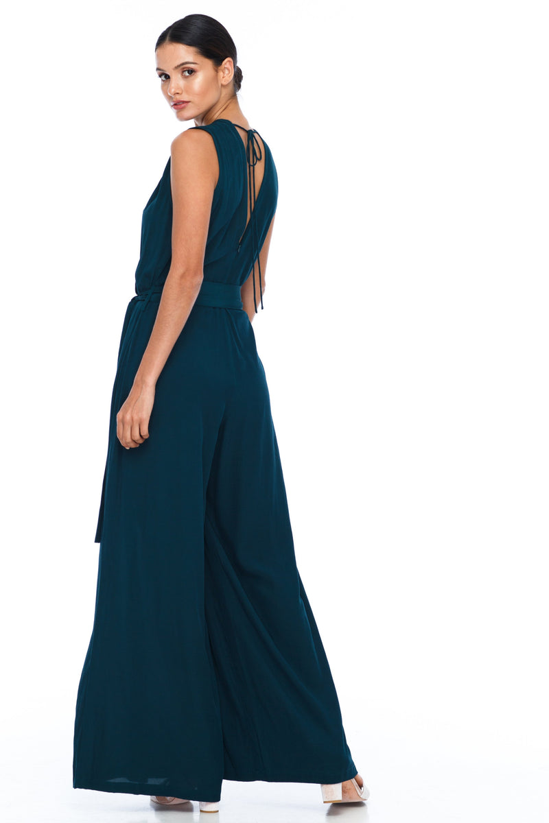 A BLAK Bridesmaid Piece - The Keep Me Jumpsuit features a beautifully low v-neck front and back, with gathered body into a wide leg. Also comes with a sash belt to bring in at waistline - Emerald - Back