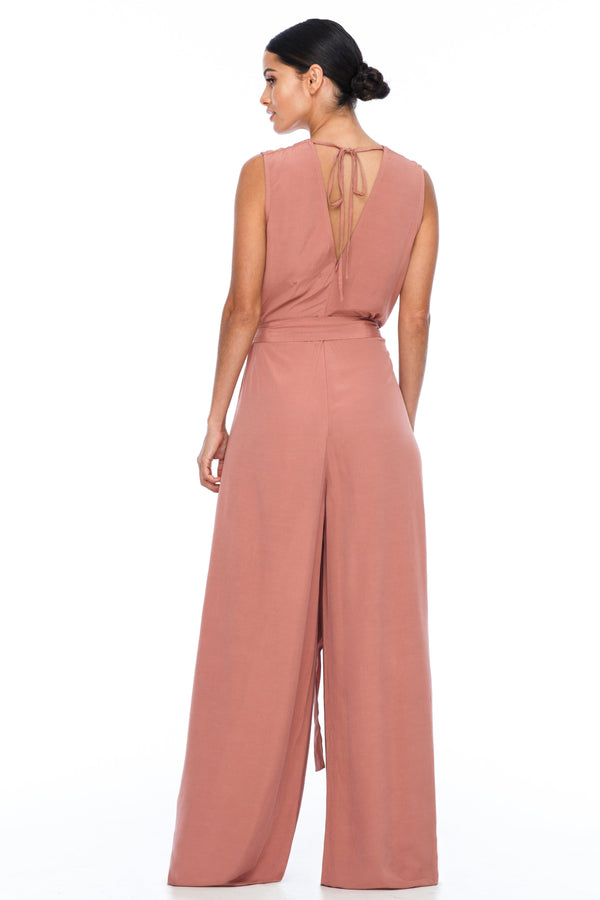 A BLAK Bridesmaid Piece - The Keep Me Jumpsuit features a beautifully low v-neck front and back, with gathered body into a wide leg. Also comes with a sash belt to bring in at waistline - Becca pink - Back View