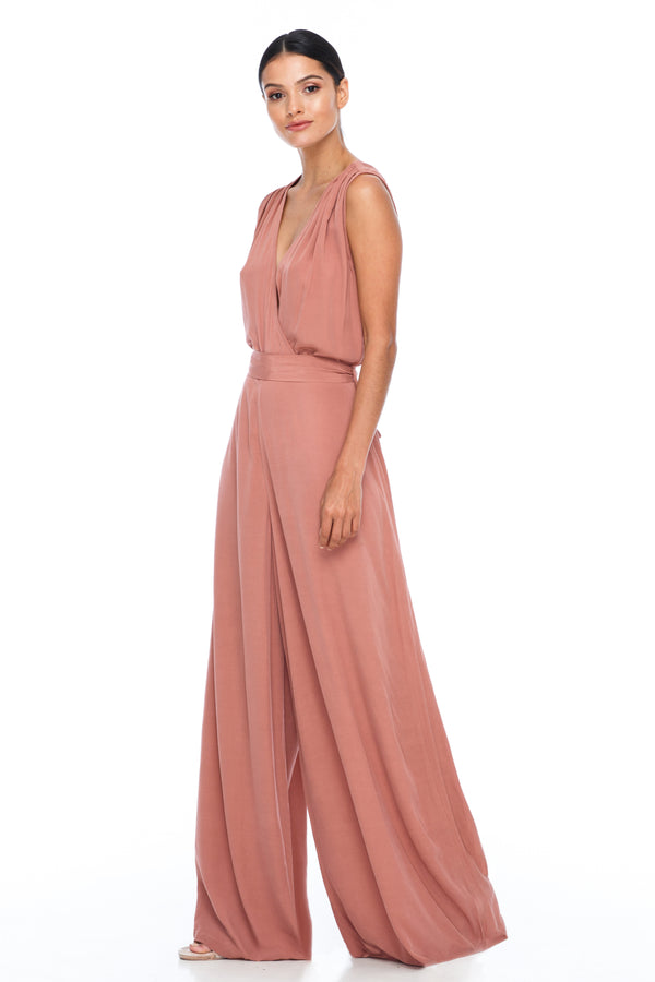 A BLAK Bridesmaid Piece - The Keep Me Jumpsuit features a beautifully low v-neck front and back, with gathered body into a wide leg. Also comes with a sash belt to bring in at waistline - Becca Pink - Front View
