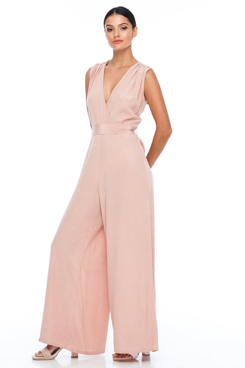 A BLAK Bridesmaid Piece - The Keep Me Jumpsuit features a beautifully low v-neck front and back, with gathered body into a wide leg. Also comes with a sash belt to bring in at waistline - Rose - Side View