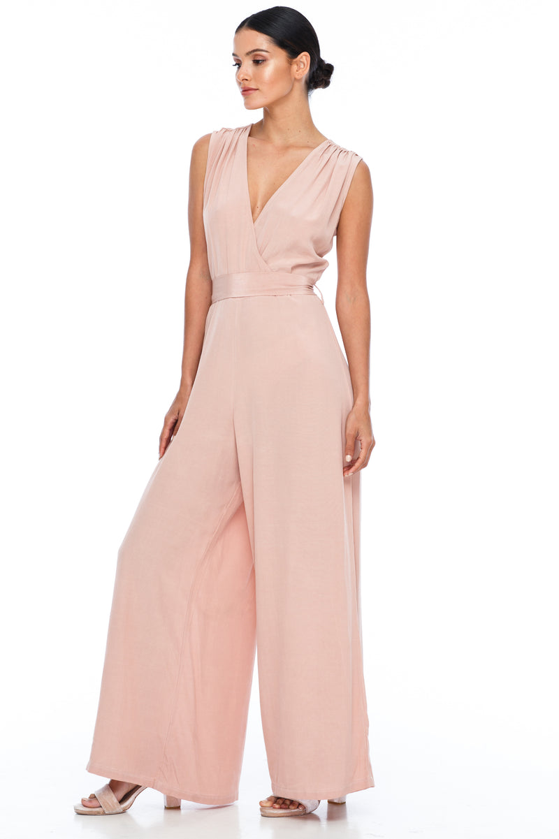BLAK Bridesmaid Jumpsuit - The Keep Me Jumpsuit features a beautifully low v-neck front and back, with gathered body into a wide leg. Also comes with a sash belt to bring in at waistline - Rose - Front