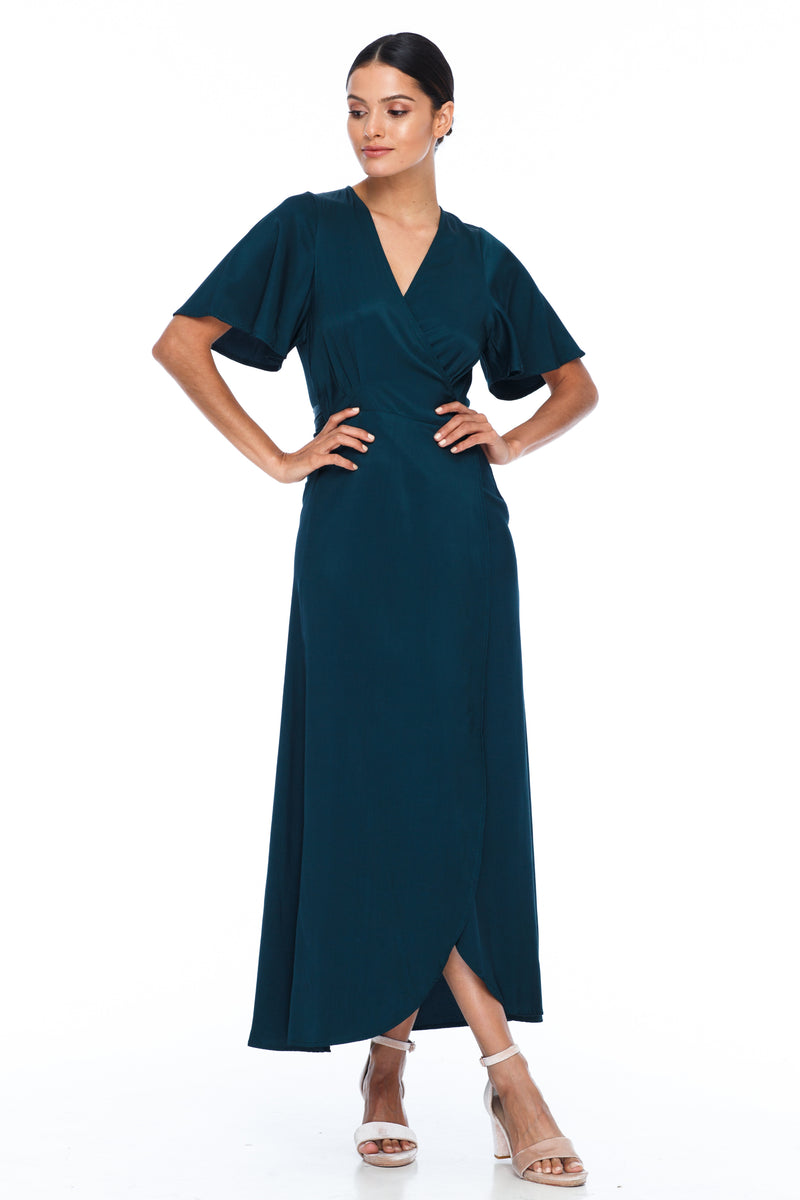 A BLAK Bridesmaid Dress. The Lights Out Bridesmaids Dress is classic wrap dress with beautiful floaty sleeve. The Slimline bodice and flowy skirt makes this style so easy to suit all body types.  Emerald