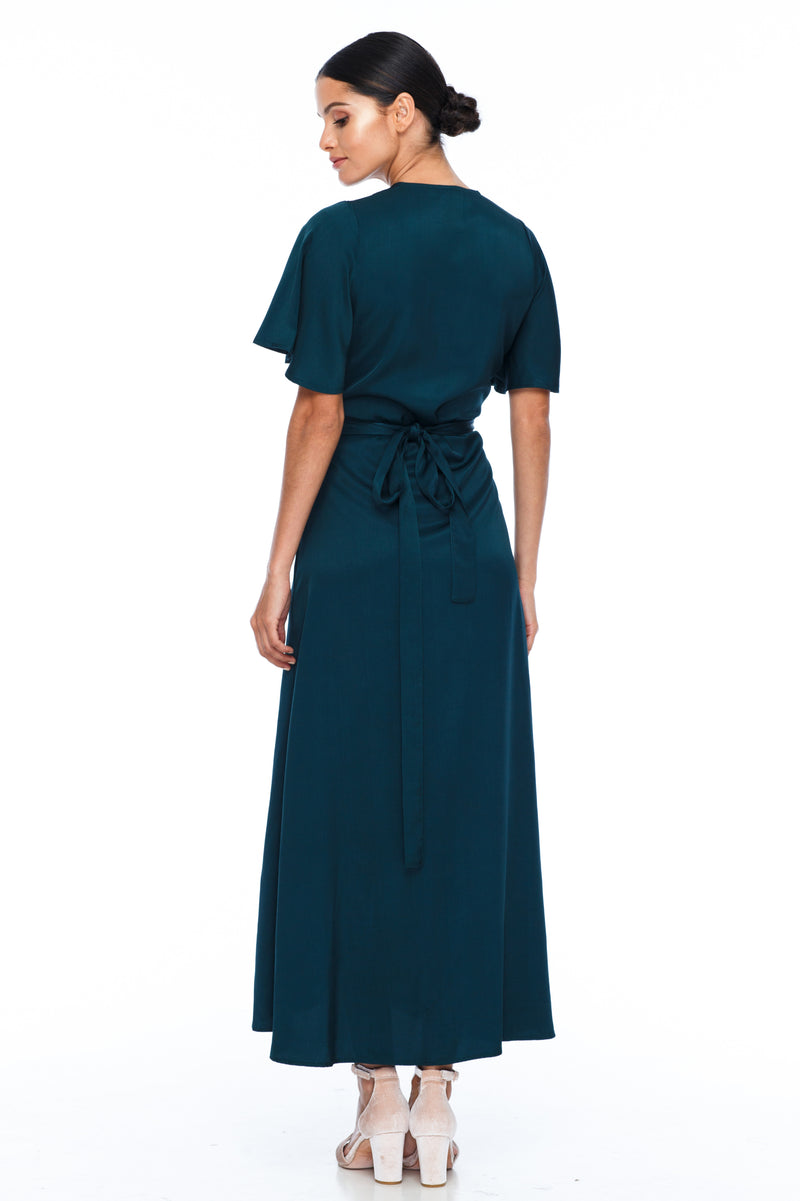 A BLAK Bridesmaid Dress. The Lights Out Bridesmaids Dress is classic wrap dress with beautiful floaty sleeve. The Slimline bodice and flowy skirt makes this style so easy to suit all body types.  Emerald - Back
