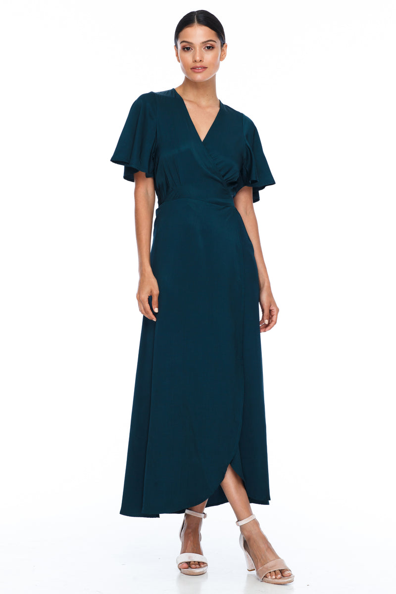 A BLAK Bridesmaid Dress. The Lights Out Bridesmaids Dress is classic wrap dress with beautiful floaty sleeve. The Slimline bodice and flowy skirt makes this style so easy to suit all body types.  Emerald - Front View