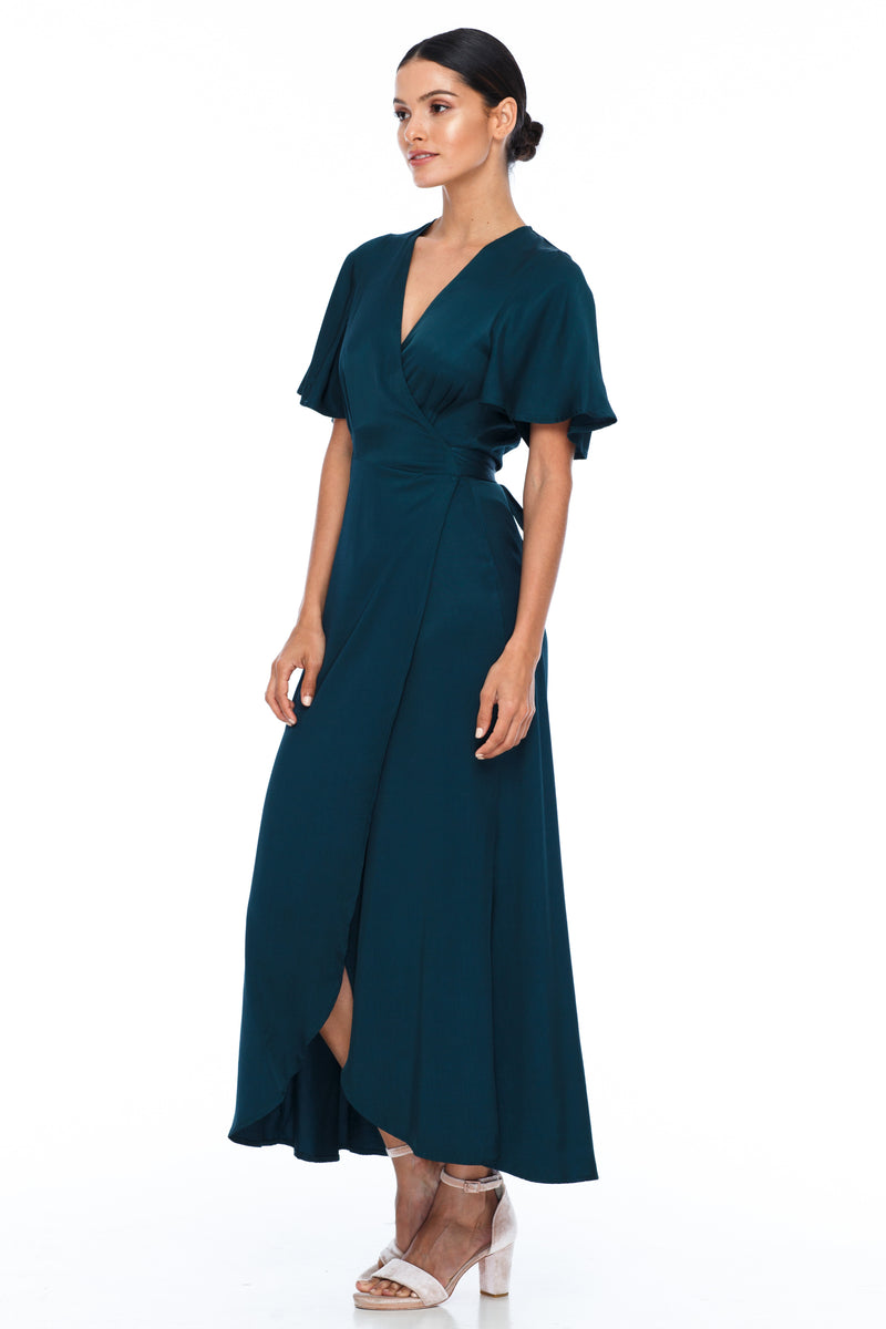 A BLAK Bridesmaid Dress. The Lights Out Bridesmaids Dress is classic wrap dress with beautiful floaty sleeve. The Slimline bodice and flowy skirt makes this style so easy to suit all body types.  Emerald - Side View