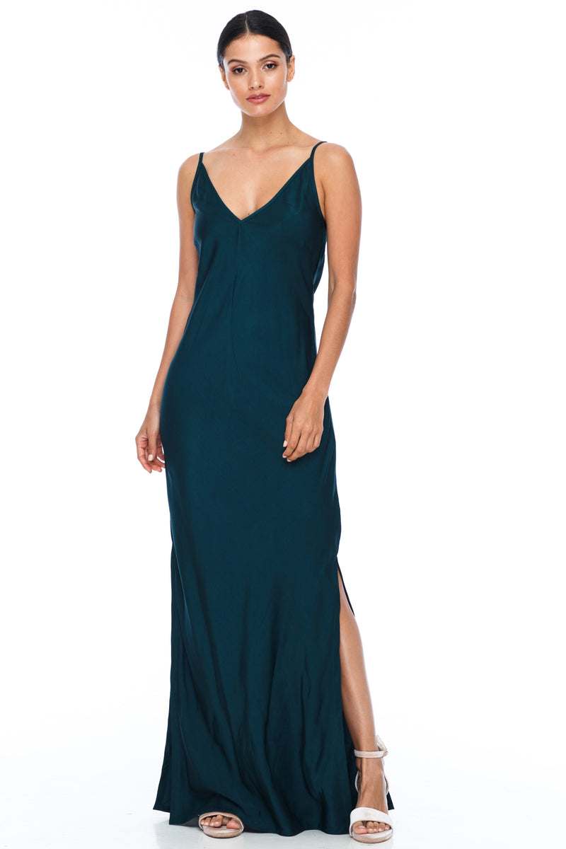 BLAK BRIDESMAIDS  The Long Cairo dress is classic and simple - cut on a bias it hugs the body and falls beautifully. The style has a deeper V neckline than our other styles, yet has adjustable straps which means the dress is able to sit higher if wanted.   This is a made to order BLAK Bridesmaids style - Emerald - Front view