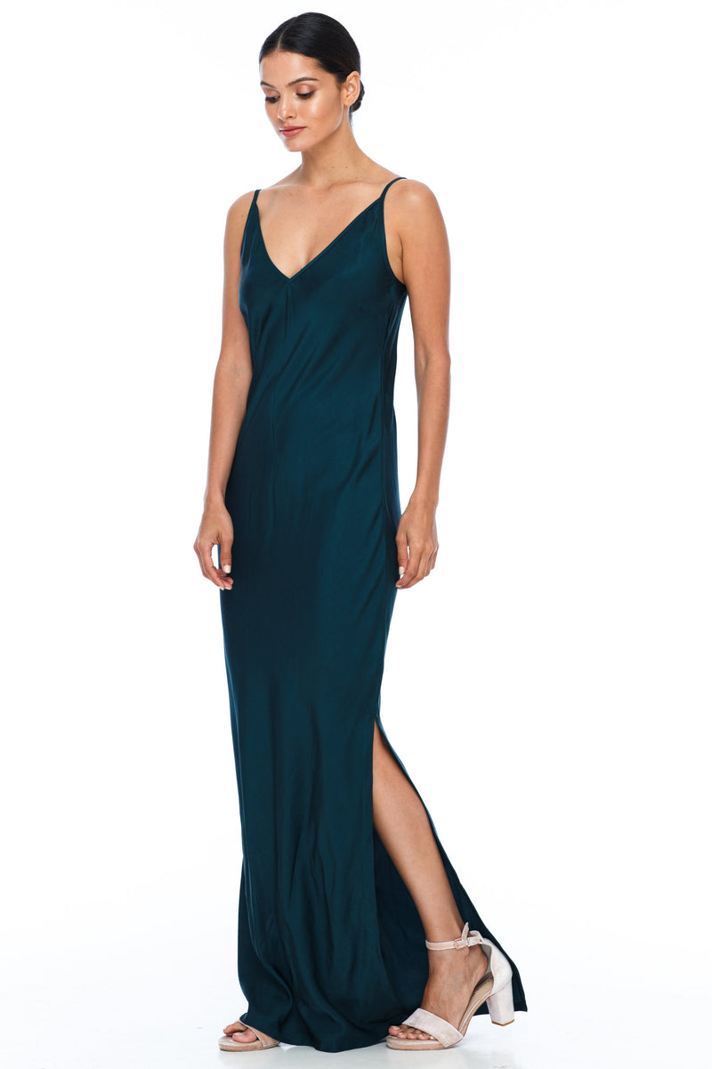 BLAK BRIDESMAIDS  The Long Cairo dress is classic and simple - cut on a bias it hugs the body and falls beautifully. The style has a deeper V neckline than our other styles, yet has adjustable straps which means the dress is able to sit higher if wanted.   This is a made to order BLAK Bridesmaids style - Emerald - Front side view