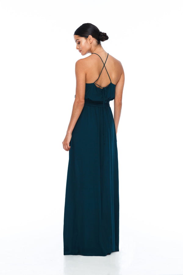 A BLAK BRIDESMAIDS PIECE  The Willow dress with a high neck line and elastic band around the waist for a sophisticated fit. Worn here with our thick ribbon wrap to tie around the waist. Gorgeous cross strap detailing at the back for an added touch - Emerald - Back view