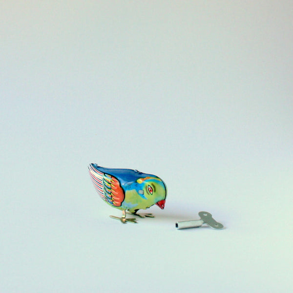 Wind-up tin toy pecking bird