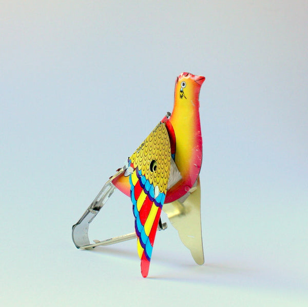 Vintage inspired tin toy flapping partridge