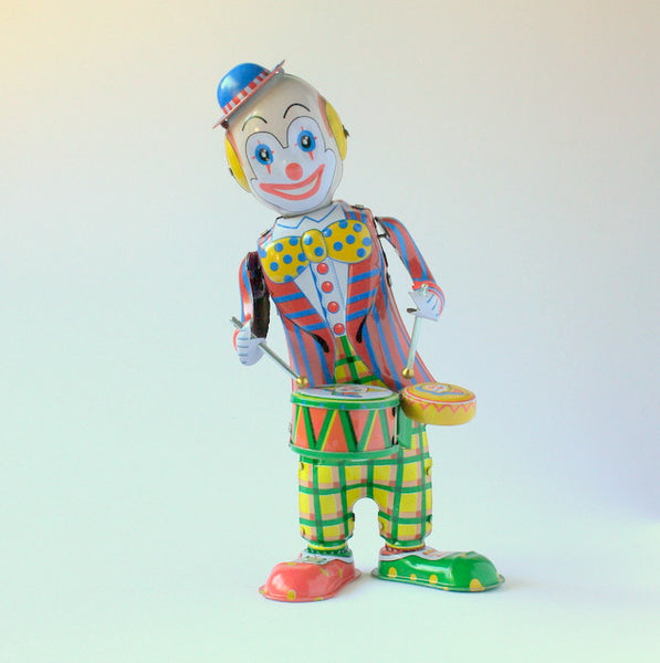 Vintage inspired tin toy clown