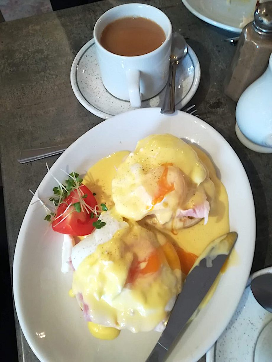 Eggs Benedict breakfast and a cup of tea