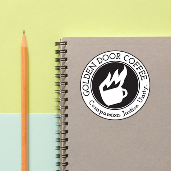 golden door coffee logo sticker notebook
