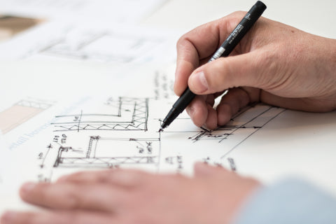 Someone drawing house plans