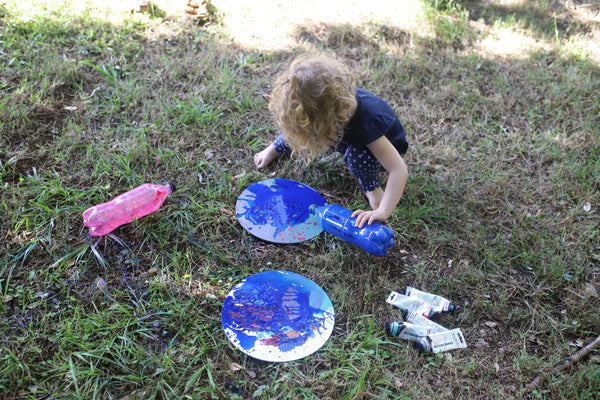 Kids painting in lockdown turns canvas bright blue