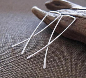 Ling bow crossover earrings in silver