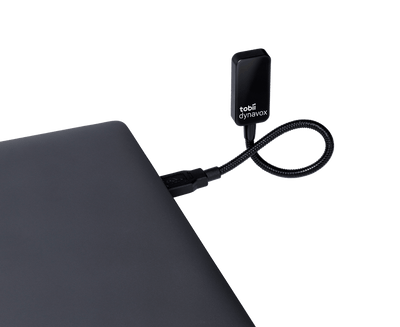 Tobii Dynavox EyeR plugged into laptop