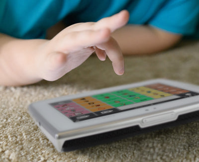 Boy using Tobii Dynavox Indi speech generating device featuring Snap Core First