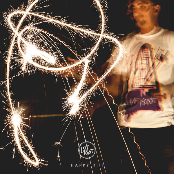 Stick tricks with sparklers. Lot Riot Independence Day.