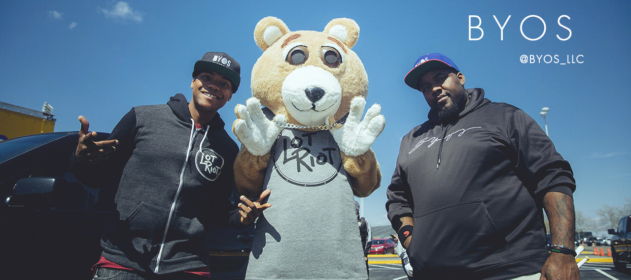 Drum duo BYOS wears Lot Riot apparel with Leon the Bear
