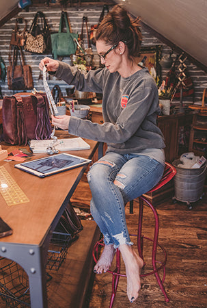 Jennifer Smith designing STS Ranchwear handbags.