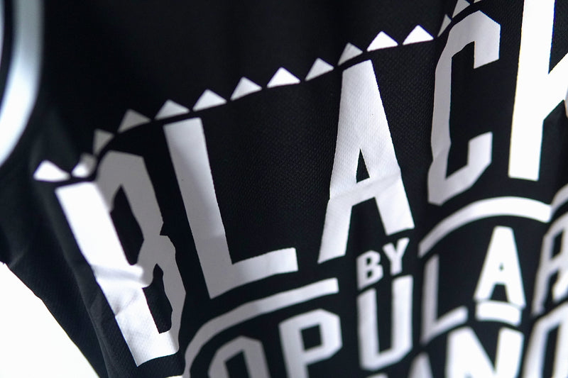 BLACK BY POPULAR DEMAND® Black Unisex Basketball Jersey