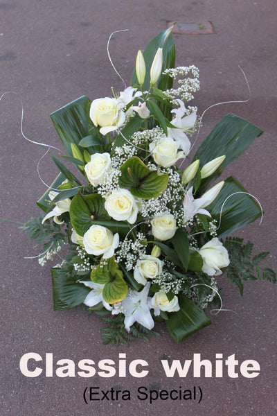 WOW FACTOR: Arrangements: (in a vase or dish with floral foam)