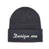 "Photo of a dark gray toque with the words ""design me"" embroidered on it."