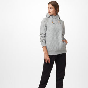 Hip woman with brown hair looking away from camera wearing a grey tentree hoodie