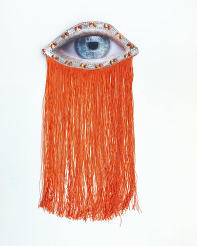 Eye Appliqué with Beaded Trim and Orange Fringe