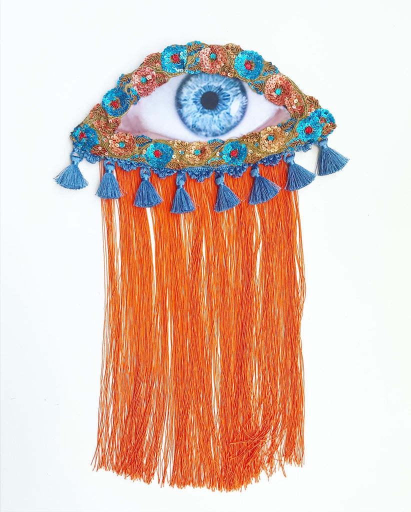 Eye Appliqué with Blue Tassels and Orange Fringe
