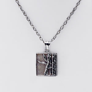 Fossil Bambu Sterling Silver Portrait Repousse Necklace - Cynthia Gale New York Jewelry