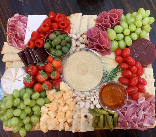 feta cheese, hummus, olives, guava paste, grapes, chocolate, cheese platters, charcuteries