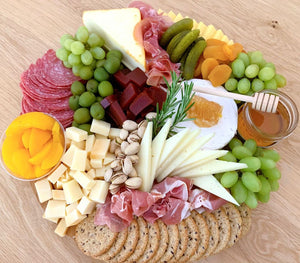 cheese platter, truffle cheese, muenster cheese, manchego, peaches, guava paste, cheese board, charcuterie board