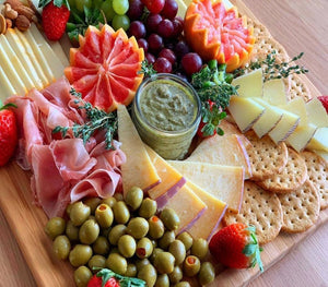 Premium platter with prima donna cheese, manchego cheese, munster cheese, serrano ham, prosciutto for events