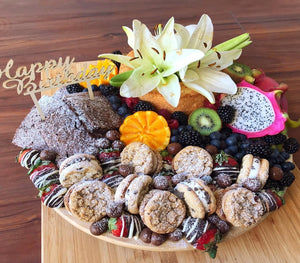 birthday platter with cake, flowers, pomegranate, cookies