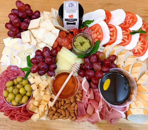 caprese board, cheese platter, sun dried tomatoes, olives, party platters, overwood, brie cheese