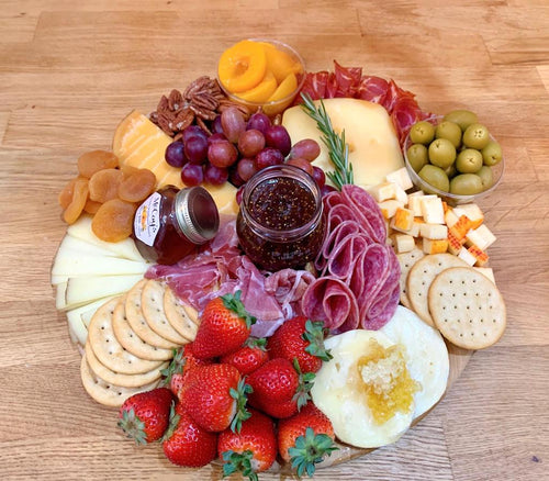 jarlsberg cheese, beemster cheese, brie cheese, cheese platter, capocolla, salami, figs
