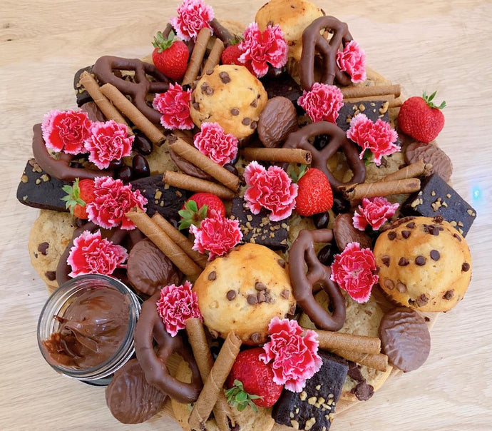 dessert platter with brownies, muffins, cookies, nutella, flowers, edible gifts