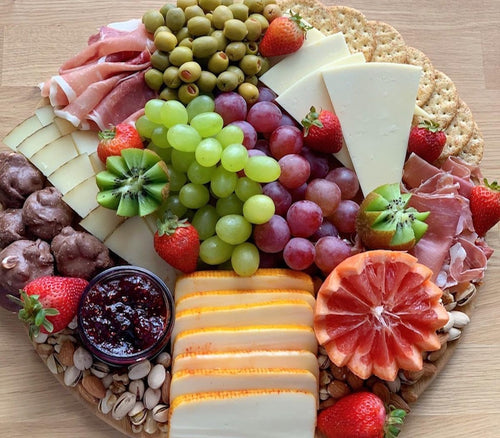 cheese board, cheese, gruyere, manchego, munster, serrano ham, party platter, charcuterie