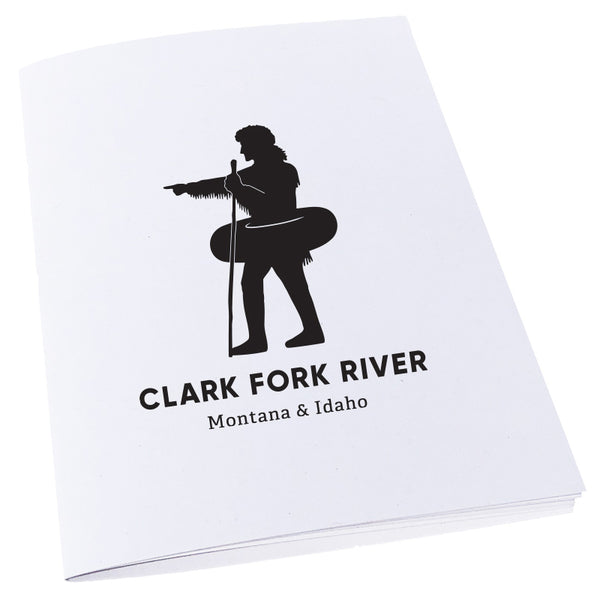 Silhouette of explorer William Clark pointing with an inner tube around his waist to signify the Clark Fork River in Missoula, MT on a notebook.