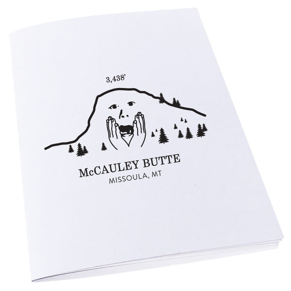 An image of a worried McCauley Butte in Missoula, Montana on a notebook.