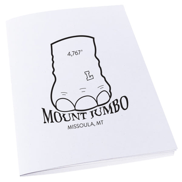 Elephant foot stomping on the words Mount Jumbo in Missoula, MT on a notebook.