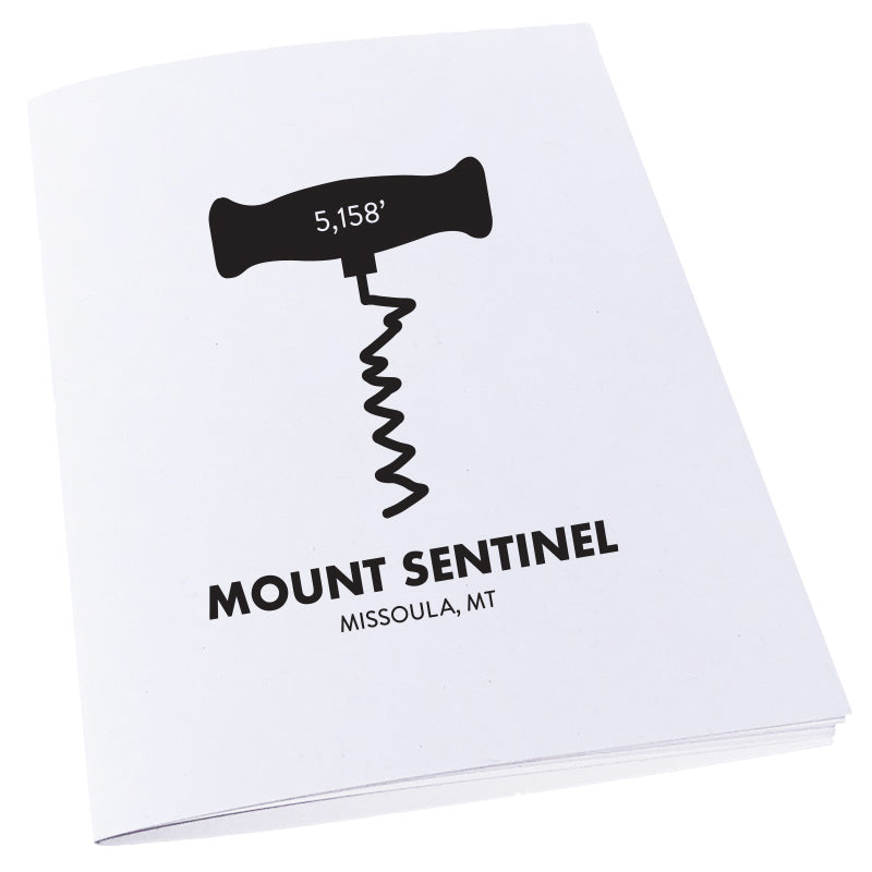 The M trail on Mount Sentinel in Missoula, MT as a corkscrew on a notebook.