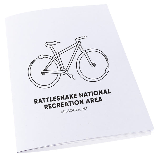 Mountain Bike made out of snakes to represent the Rattlesnake National Recreation Area near Missoula, MT on a notebook.