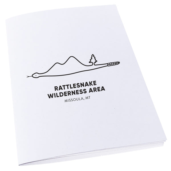 Image of Rattlesnake Wilderness Area in Missoula, Montana inside of a snake on a notebook.
