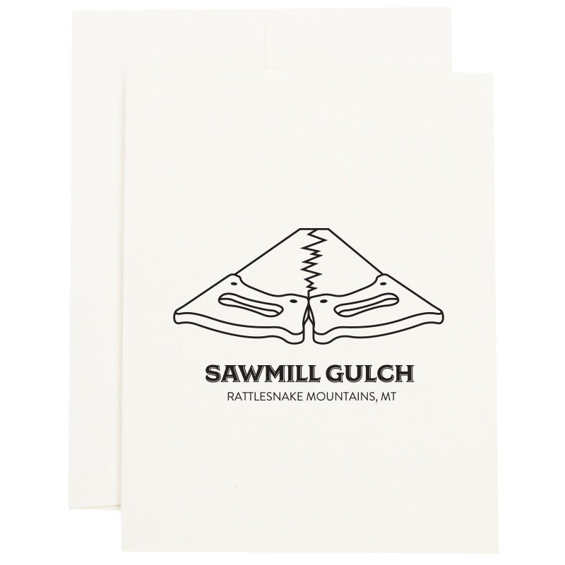 Image of two saws placed tooth-edge to tooth-edge to represent Sawmill Gulch in Missoula, MT on a greeting card.