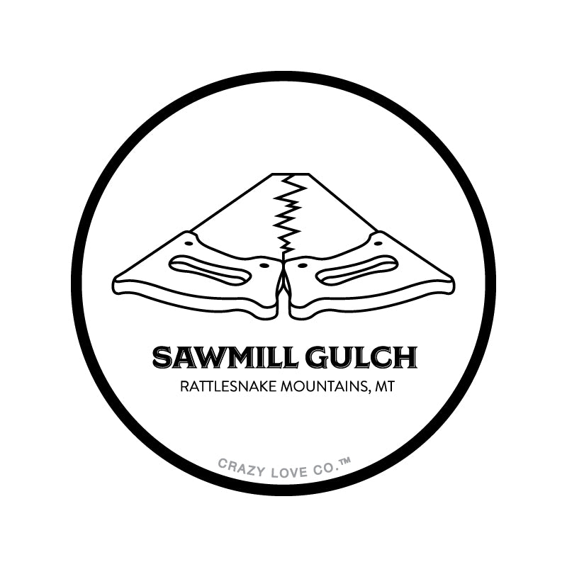 Image of two saws placed tooth-edge to tooth-edge to represent Sawmill Gulch in Missoula, MT on a sticker.