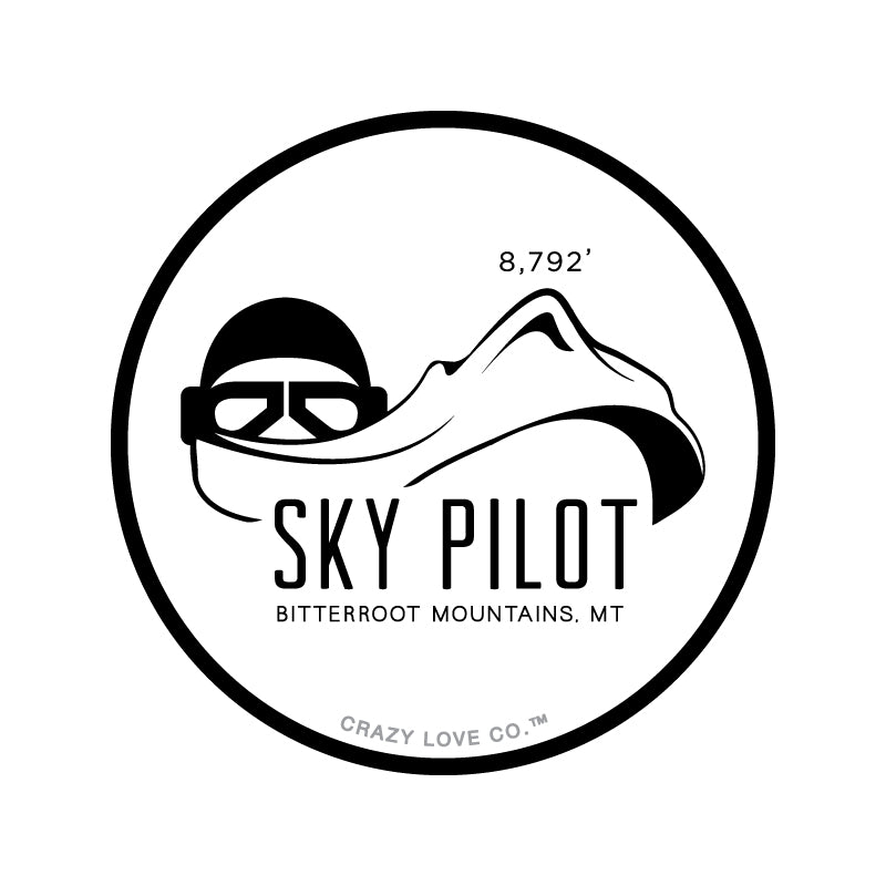 Image of a World War 2 era pilot whose scarf is a mountain to represent Sky Pilot in the Bitterroot Mountains near Missoula, MT on a sticker.
